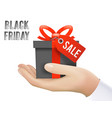hand holding black friday gift box sale discount vector image