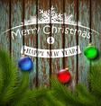 christmas balls and christmas tree on a wooden vector image