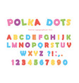 Festive polka dots font colorful abc letters and vector image