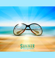 sunglasses lying on the beach in the sand on a vector image vector image