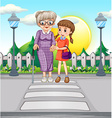 Girl helping old woman crossing the road vector image