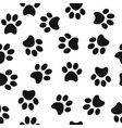 black animal paw prints seamless pattern vector image