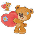 teddy bear holding a red heart in his paws vector image
