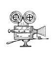 old movie camera engraving vector image