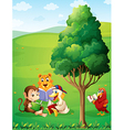 Animals reading under the tree at the hilltop vector image