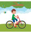 Boy rides a bike vector image