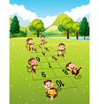 Monkeys playing hopscotch in park vector image vector image