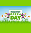 earth day poster with green grass and flowers vector image