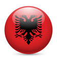 Round glossy icon of albania vector image