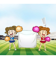 Two young cheerers with an empty banner vector image
