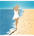girl in a dress walking on the beach vector image