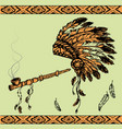 native american peace pipe and chief headdress vector image