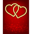 Two golden linked hearts vector image