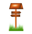 wooden direction sign standing in the grass vector image