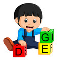 baby boy and alphabet blocks cartoon vector image