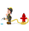 fireman holding a yellow water hose vector image