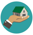 businessman holding in hand a house vector image