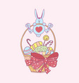 easter bunny hanging on the handle of the wicker vector image