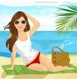 brunette sunbathing on beach sitting on a towel vector image