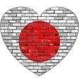 Flag of Japan on a brick wall in heart shape vector image