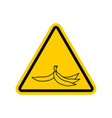 Attention garbage peel from banana on yellow vector image