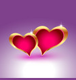 Two realistic hearts in gold metal frames vector image
