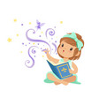 excited toddler girl sitting with open magic book vector image