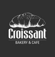 sketch of a croissant on black background vector image
