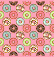 donuts seamless pattern on pink background vector image