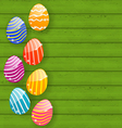 Easter colorful eggs on wooden texture vector image vector image