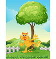 A playful tiger under the tree at the hilltop vector image vector image