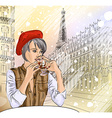 Lady Enjoying a Drink in the Snowy City of Paris vector image