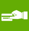 hand holding a credit card icon green vector image