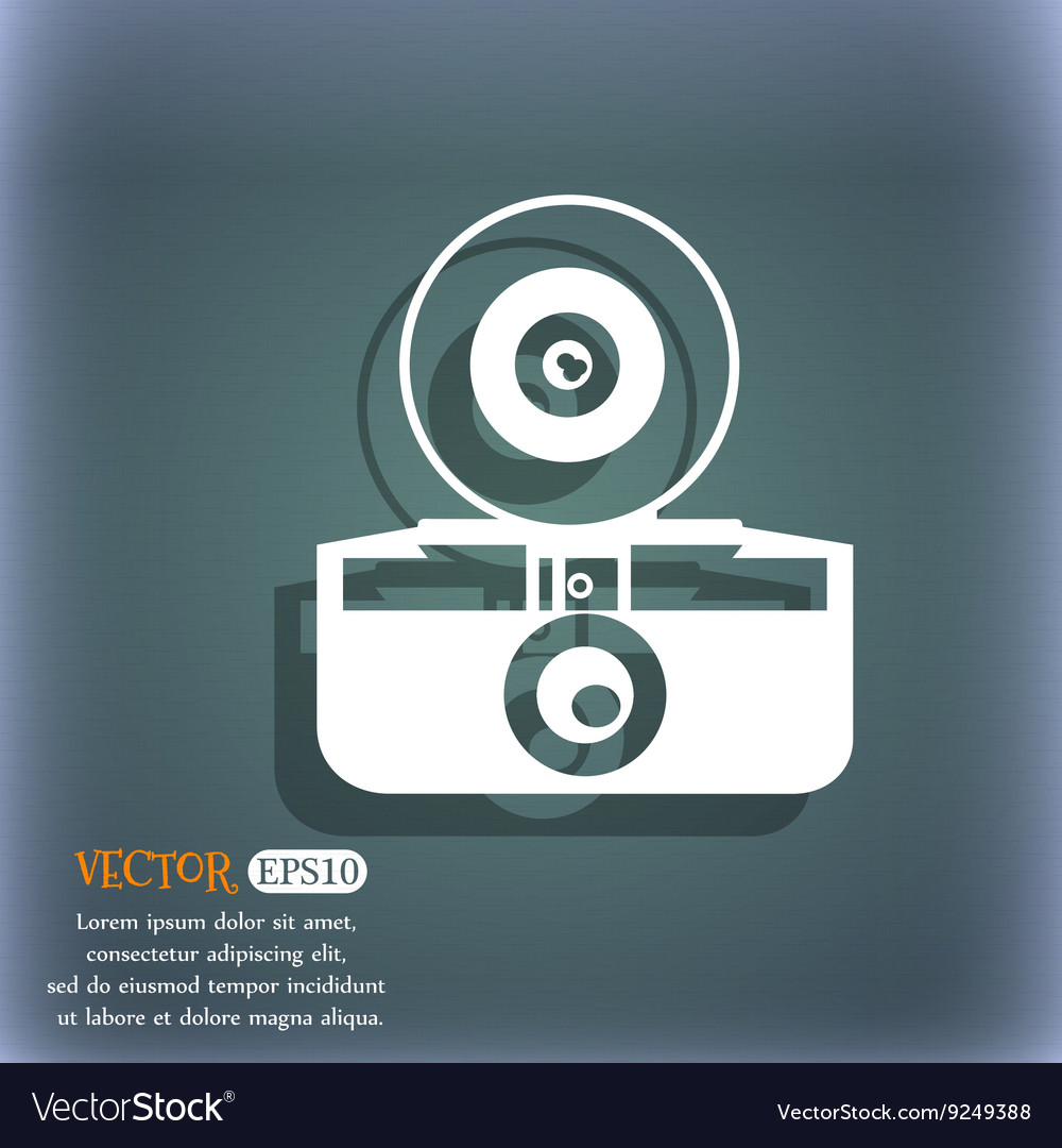 Retro photo camera icon on the bluegreen abstract vector