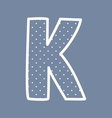 K alphabet letter with white polka dots on blue vector image