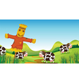 A scarecrow and cows vector image