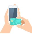 Hands holding credit card and smartphone vector image