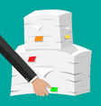 hand with pile of papers office documents heap vector image