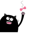 black cat head looking at pink bow hanging on vector image