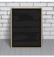 Black chalkboard with wooden frame on brick wall vector image