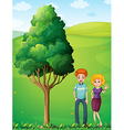 A couple at the hilltop standing near the tree vector image