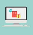 computer with gift shopping bag icon vector image