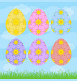 set of colored isolated easter eggs on a blue vector image
