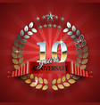 Anniversary 10th gold wreath with red ribbon vector image