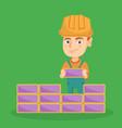 caucasian bricklayer boy building a brick wall vector image