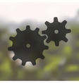 cogwheel icon on blurred background vector image