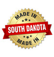 Made in south dakota gold badge with red ribbon vector image