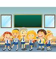Students in uniform standing in classroom vector image vector image