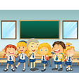Students in uniform standing in classroom vector image