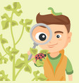 boy looking through a magnifying glass at ladybug vector image